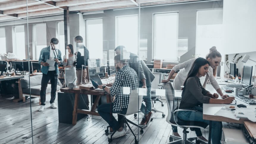 a group of people working in an office space