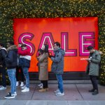 Customers queue outside a department store ahead of the Boxing Day sale in central London on December 26, 2018.