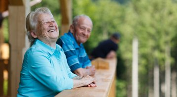 Happy senior couple looking to surroundings areas and smiling.