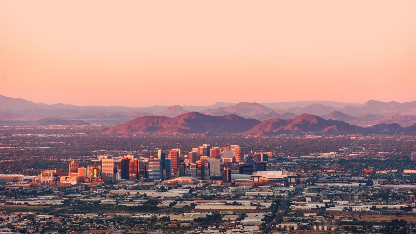 Phoenix Arizona with its downtown lit by the last rays of sun at the dusk