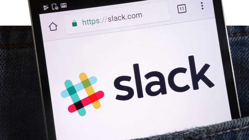 Slack website displayed on smartphone hidden in jeans pocket