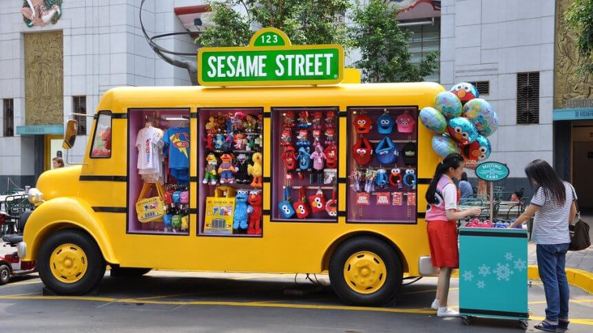 Yellow truck that sells Sesame Street merchandise at Universal Studios Singapore