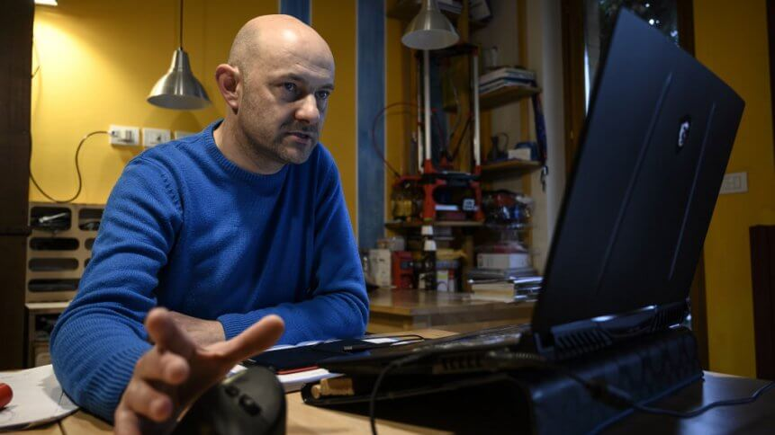 Italian engineer Mario Milanesio works on a 3D-printing project of respiratory valve fittings.