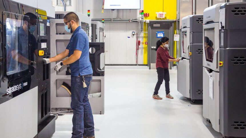 General Motors 3D printing team members working at the still-under-construction Additive Innovation Center.