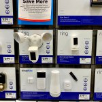 Ring and Google Nest security cameras on display inside a Lowe's home improvement store