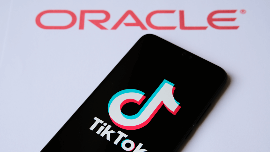 TikTok and Oracle partnership concept photo. TikTok logo seen on the smartphone and Oracle company logo seen on the blurred background
