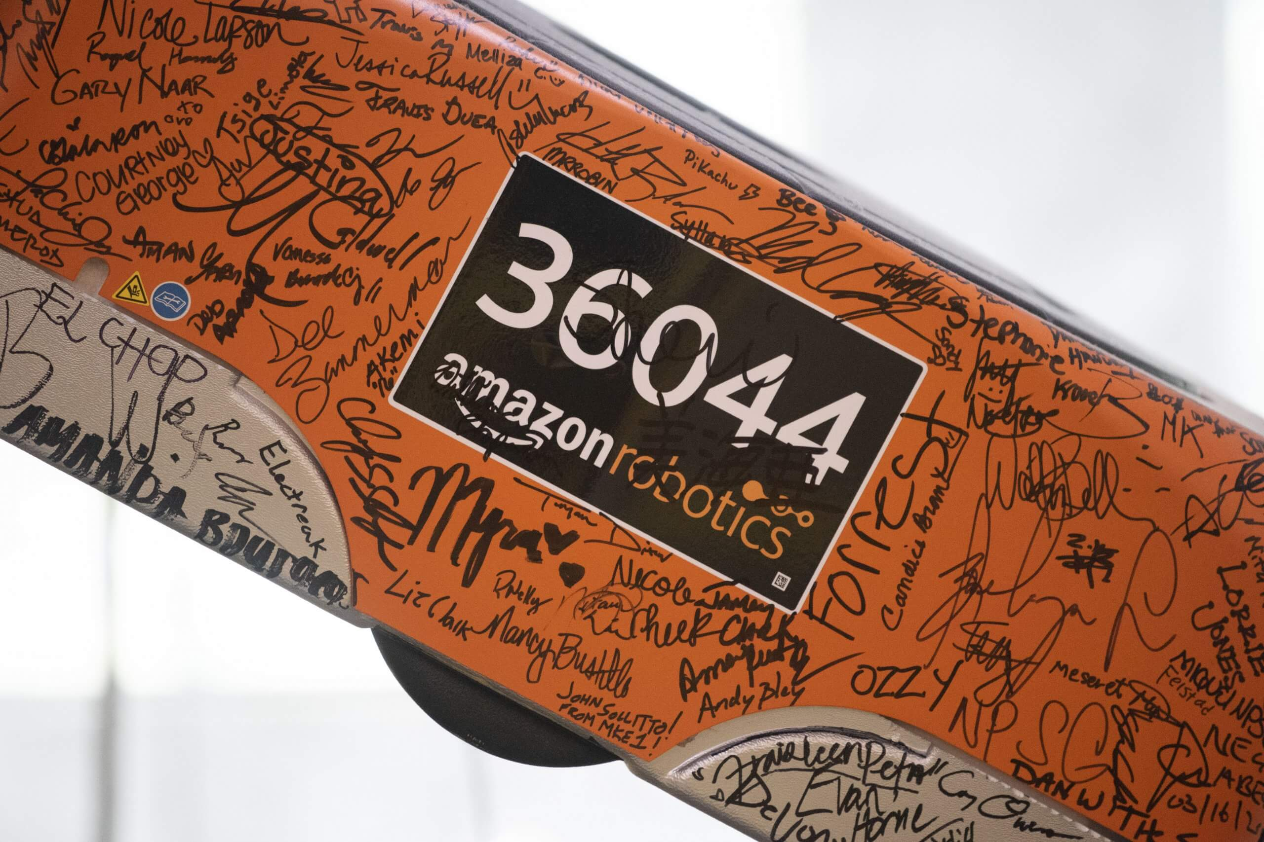 Amazon Robotics works, signed by the entire staff on the opening day of the Kent, Washington Fulfillment Center in March of 2016, hangs over the entrance during a tour September 21, 2018 in Kent, Washington.